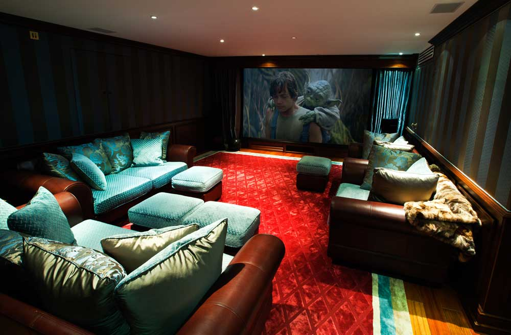 Home cinema with screen, curtains and projector.