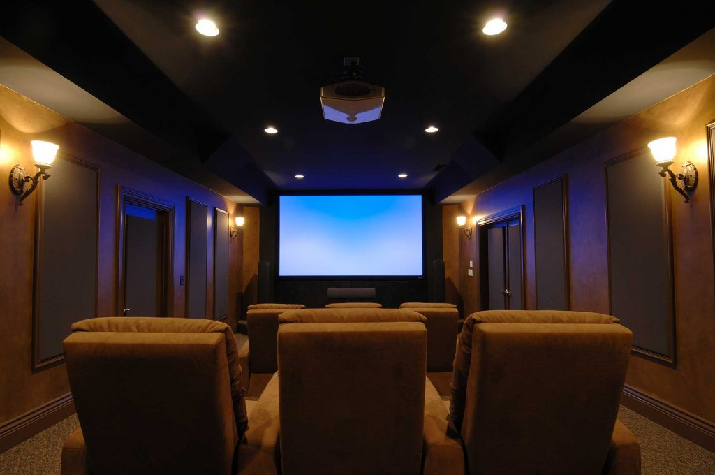Home cinema with screen and projector.