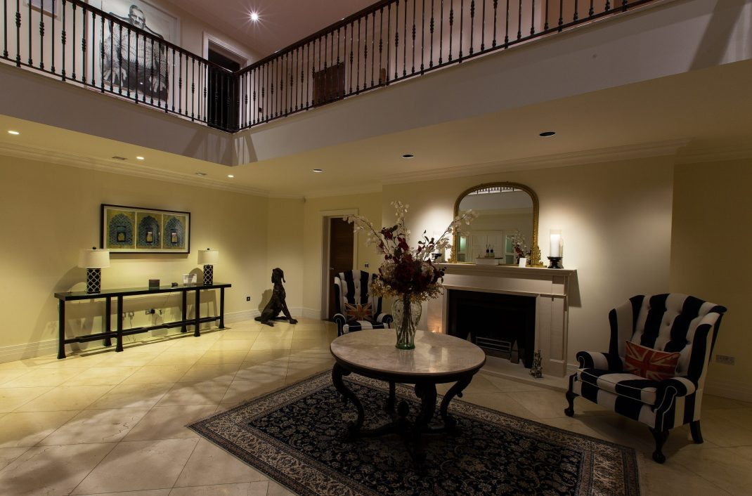 A wide shot of the hallway where we have used Lutron Homeworks QS upgrade and Deltalight light fittings.