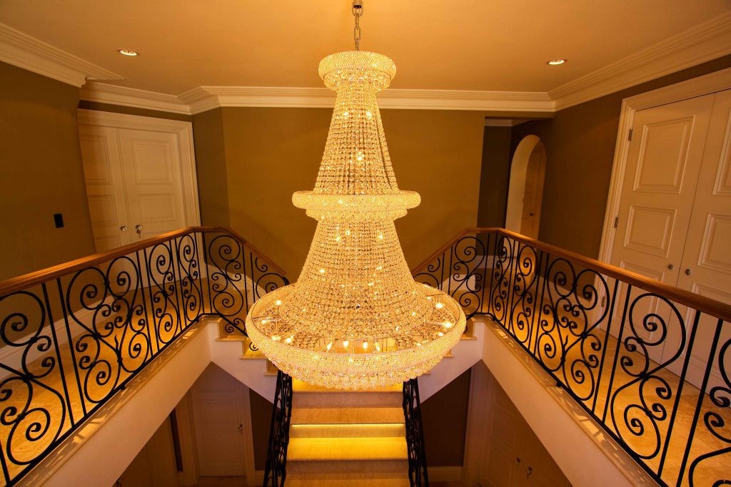 Hall lighting with large chandelier, controlled by lighting system
