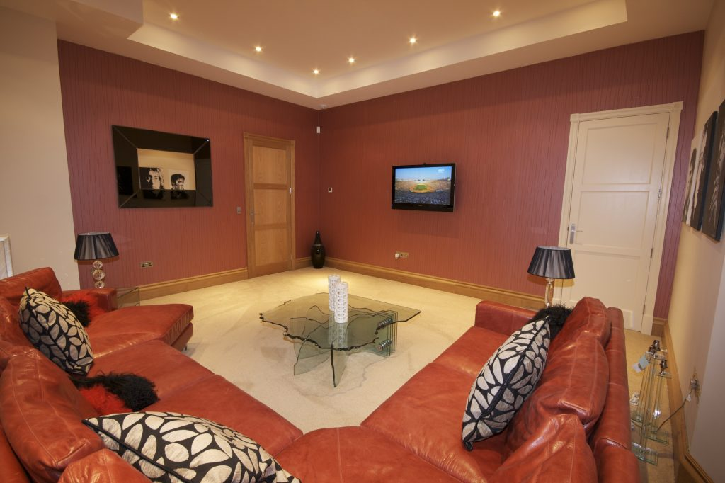 Family room with invisible speakers, part of a whole house technology solution.