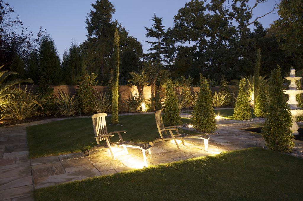Kent home with outside lighting, low level path lights and up-lit accents.