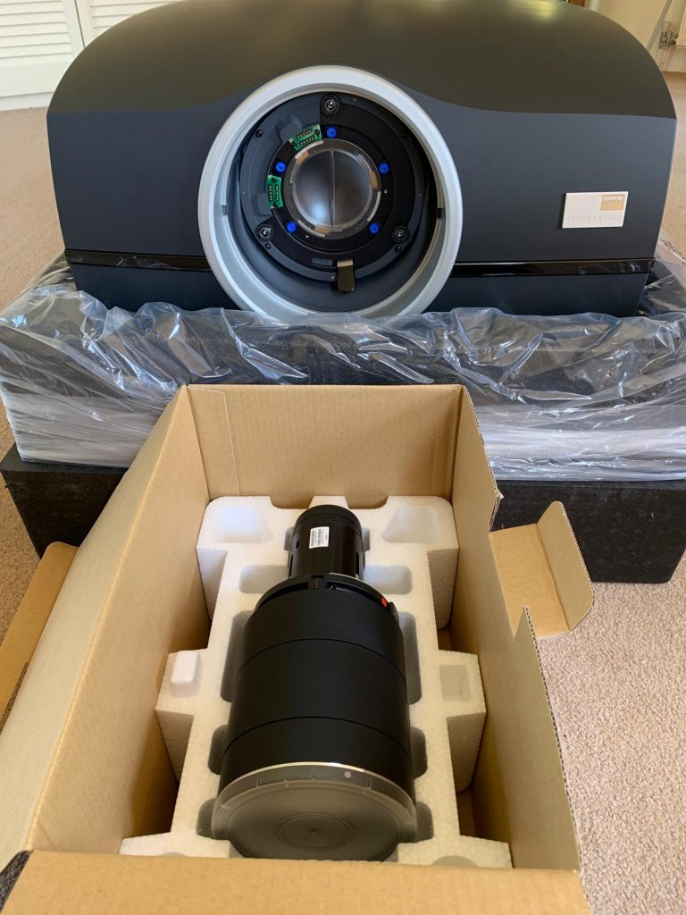 Shows home cinema projector being unpackaged ready for install