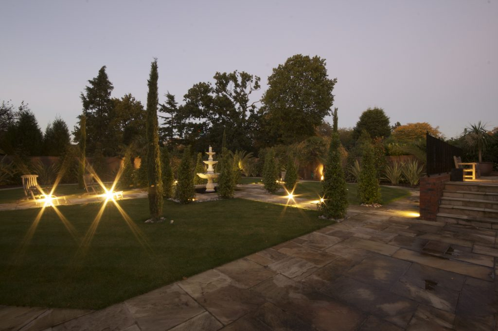 Outside lighting in this Kent home, with low level path lights, accept lights and patio lighting