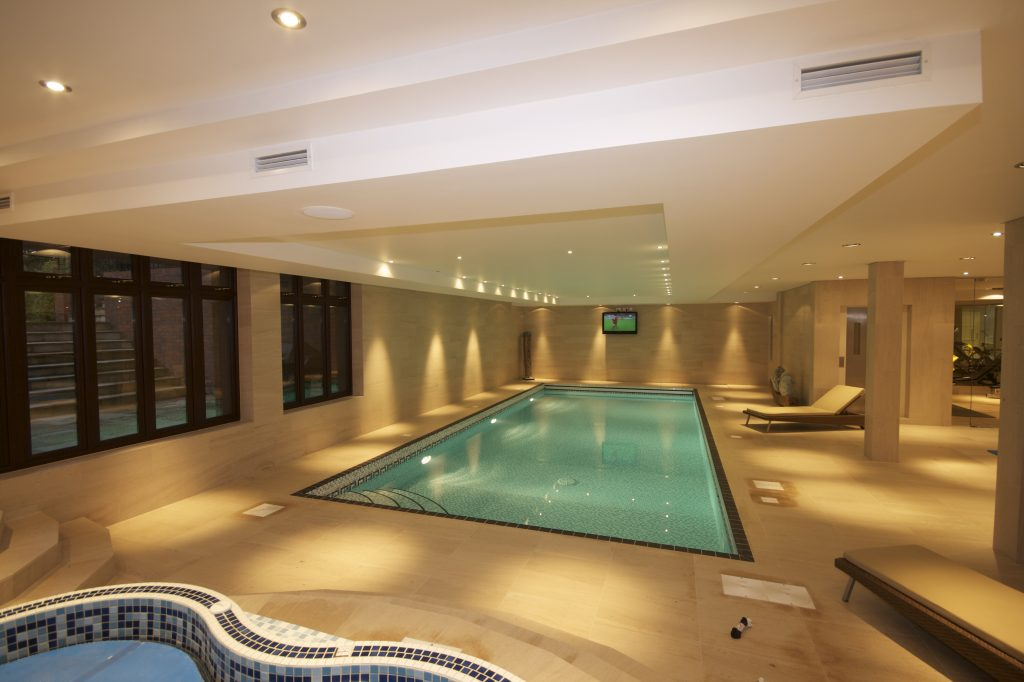 Smart home technology in pool area, shows lighting control, audio system and video distribution.