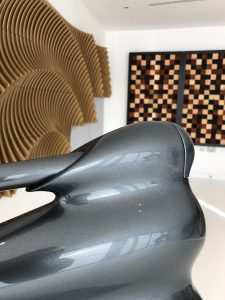 Bowers and Wilkins Nautillus loudspeaker with acoustic room treatment in background.