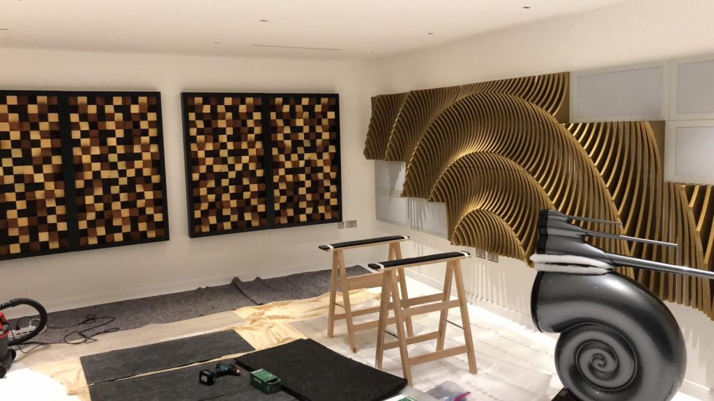 Installation of acoustic treatment in audio room.