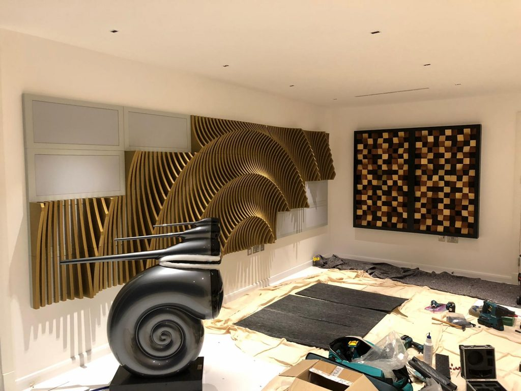 Shows installation of acoustic room treatment in ammonite room, with B&W Nautillus speaker.