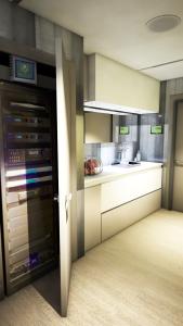 Communal cinema kitchenette and equipment rack.