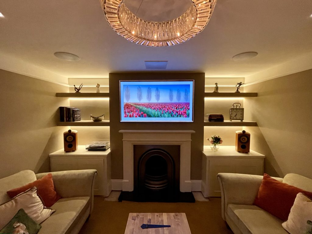 Picture Frame TV above Fireplace in Media Room