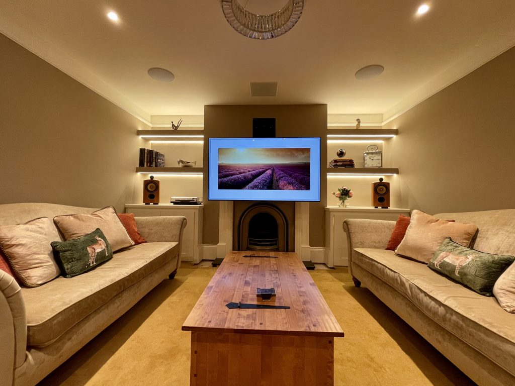 Motorised Art Screen TV bracket, motors the screen to a comfortable viewing height.