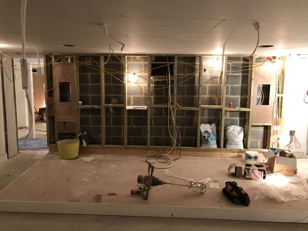 Image shows construction of rear wall of home cinema and wiring.