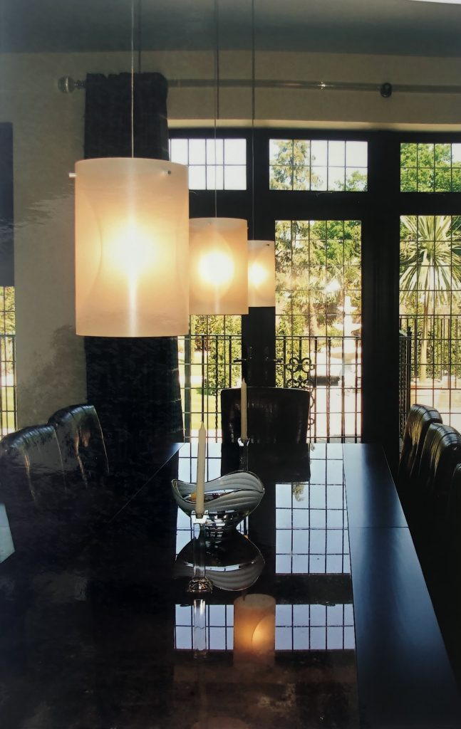 Elegant smart lighting for dining room, showing fittings above dining table
