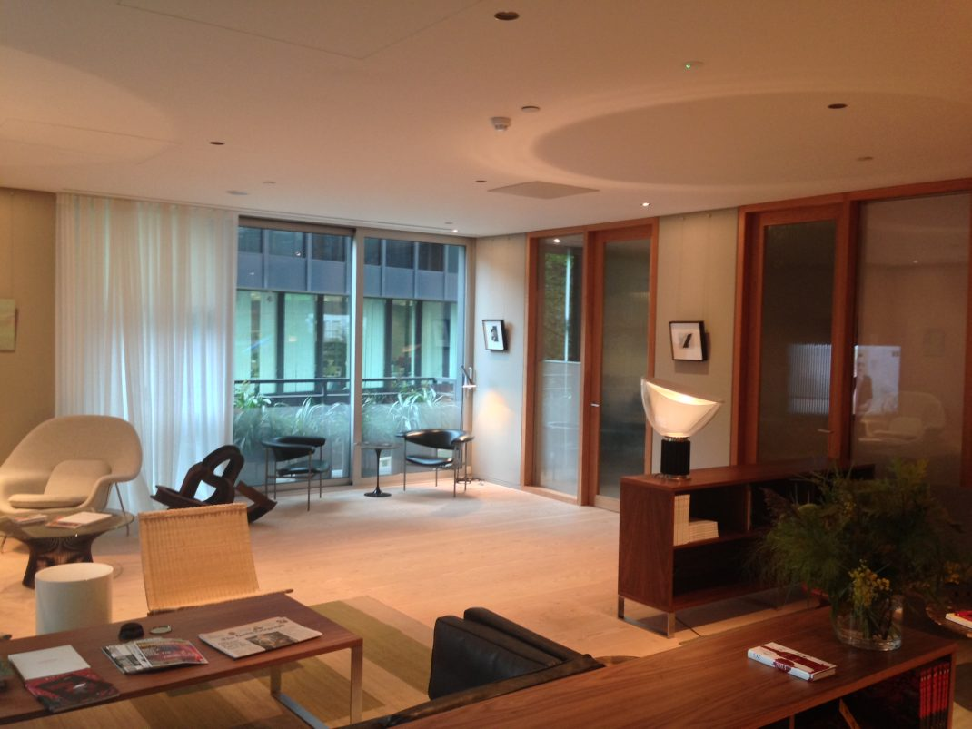 The finished reception area and meeting rooms with Lutron Energi Savr Node Lighting