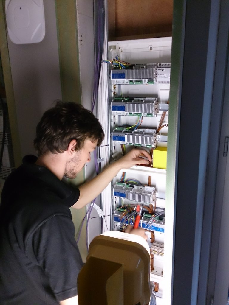 Engineer working on panel with Lutron dimmer.