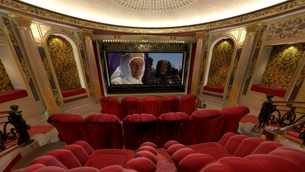 Home cinema screen and seating, view from rear towards screen. Shows red seating and lighting.